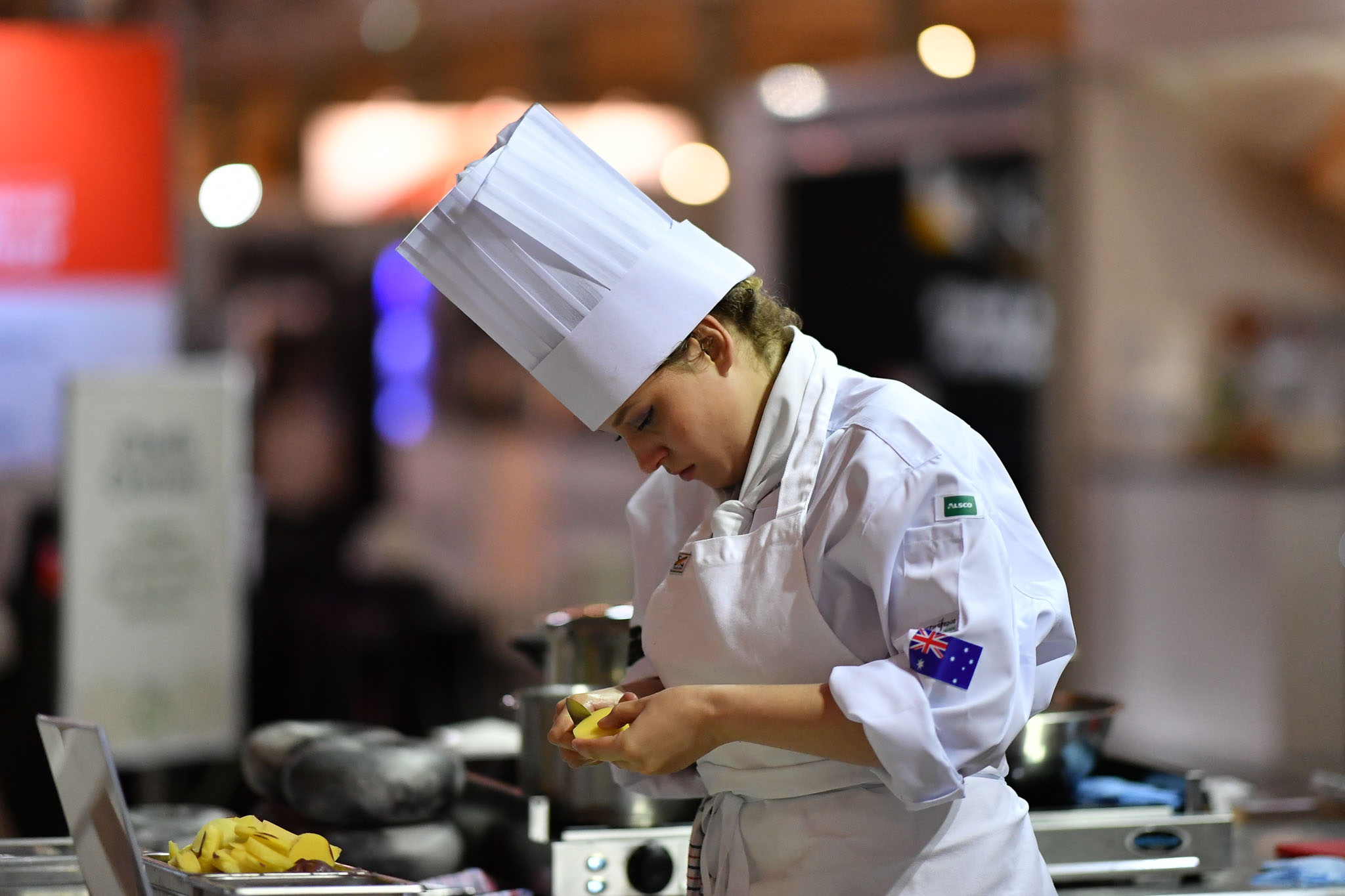 Melbourne, 30 May 2017 - Laura Skvor commis chef assisting Michael Cole of the Georgie Bass CafÈ & Cookery in Flinders prepares potatoes at the Australian selection trials of the Bocuse d'Or culinary competition held during the Food Service Australia show at the Royal Exhibition Building in Melbourne, Australia. Photo Sydney Low