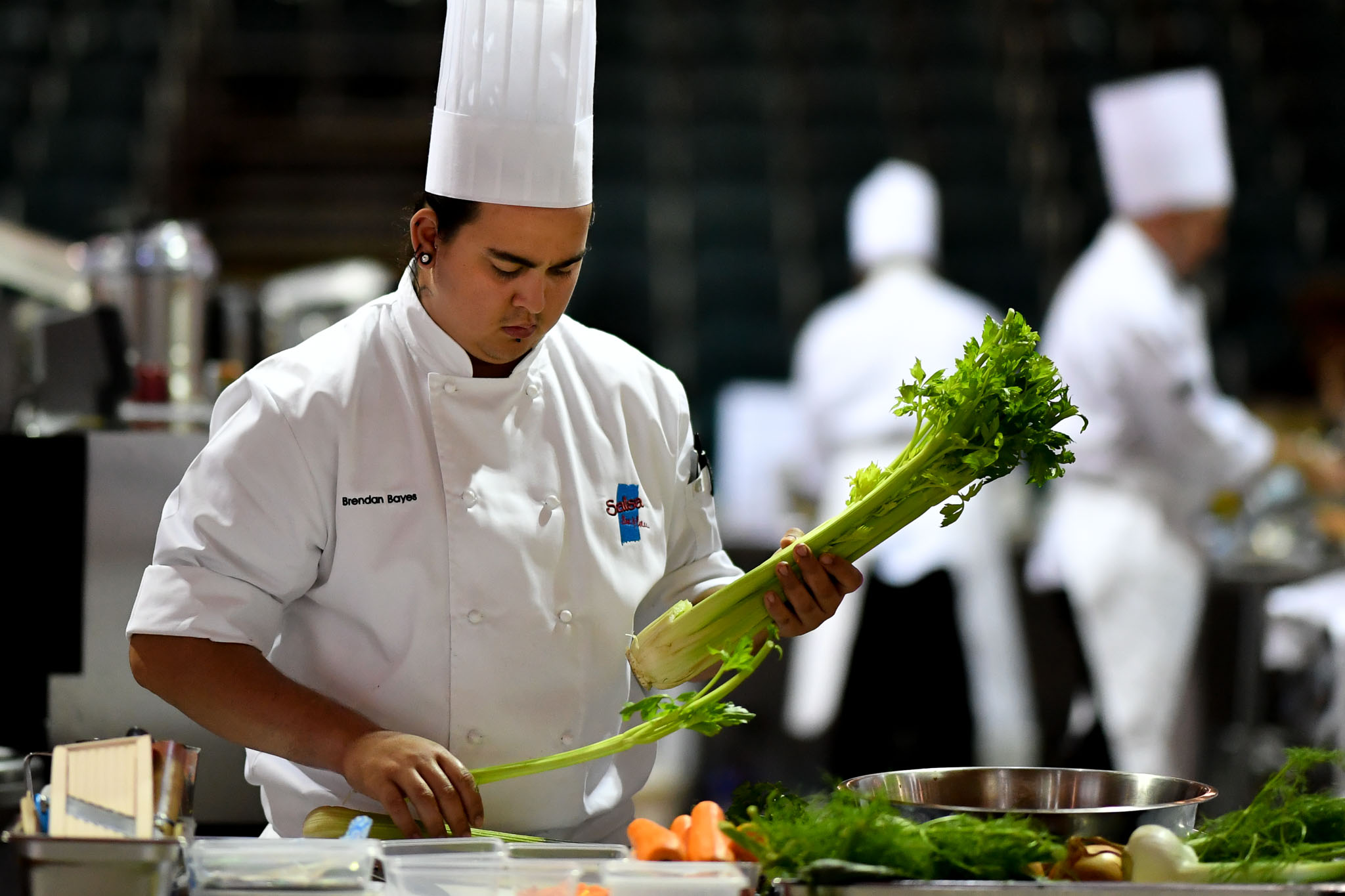 Melbourne, 30 May 2017 - Brendan Bayes commis chef assisting Tyson Kromhout of the Salsa Bar & Grill in Port Douglas prepares vegetables at the Australian selection trials of the Bocuse d'Or culinary competition held during the Food Service Australia show at the Royal Exhibition Building in Melbourne, Australia. Photo Sydney Low