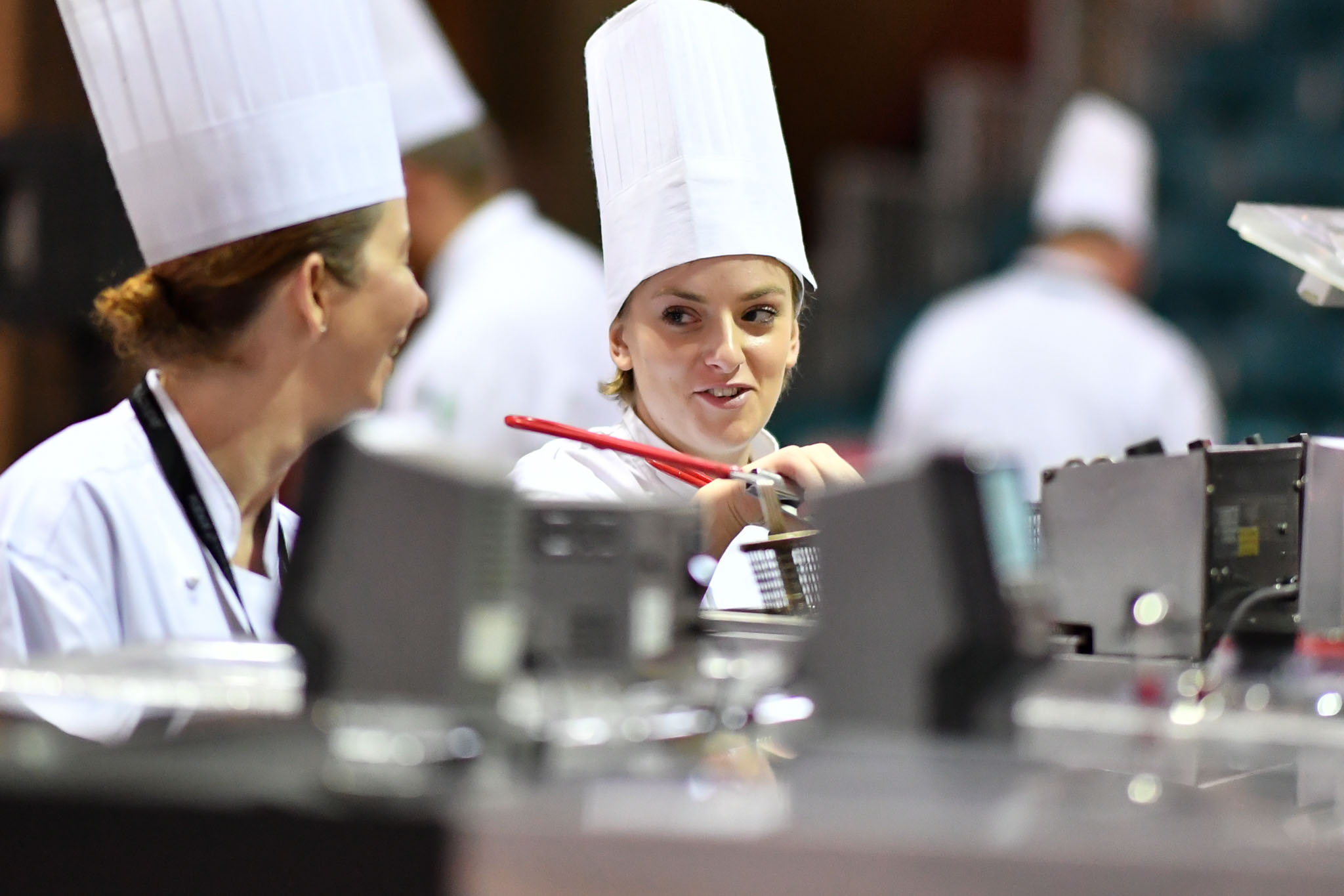 Melbourne, 30 May 2017 - Brooke Noble commis chef assisting Andrew Ballard of the Simmer Culinary in Mornington talks to Karen Doyle from Le Cordon Bleu kitchen invigilator judge at the Australian selection trials of the Bocuse d'Or culinary competition held during the Food Service Australia show at the Royal Exhibition Building in Melbourne, Australia. Photo Sydney Low