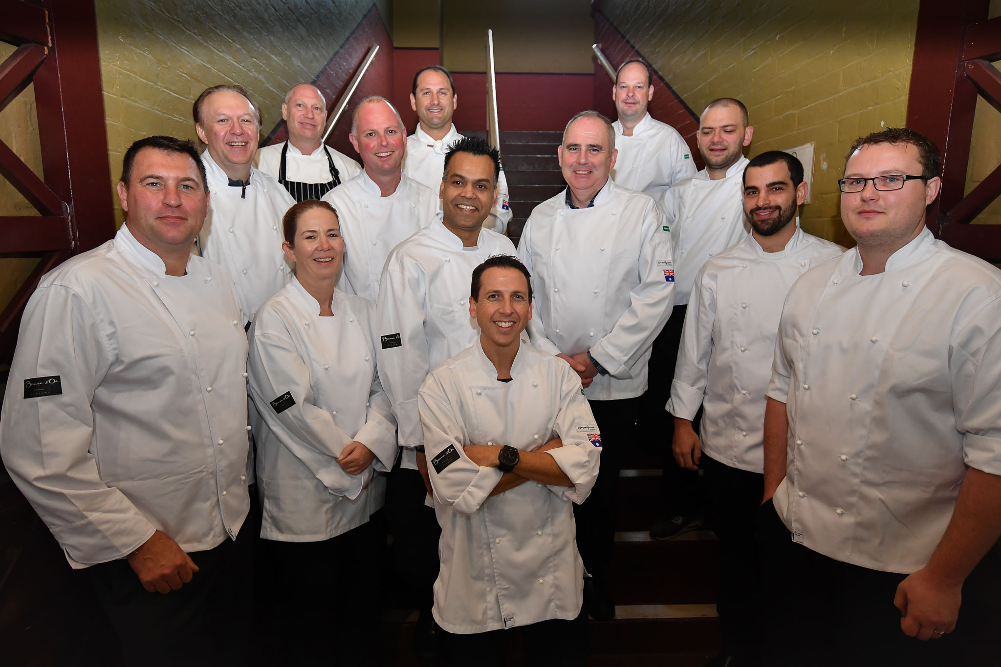 Melbourne, 30 May 2017 - The judges pose for a photograph at the Australian selection trials of the Bocuse d'Or culinary competition held during the Food Service Australia show at the Royal Exhibition Building in Melbourne, Australia.   Mark Agius from the William Angliss Institute a judge of the fish plate Donovan Cooke from The Atlantic Restaurant a judge of the fish plate Alexander McIntosh from At The Heads a judge of the fish plate Andre Smaniotto from the Geelong Cats a judge of the fish plate Simon Cosentino former Commis competitor Bocuse d'Or 2007-9 a judge of the meat plate Florent Gerardin from the Newmarket Hotel a judge of the meat plate Deepak Mishra from The Langham Hotel a judge of the meat plate Mark Weatherley from Les Toques Blanches a judge of the meat plate Karen Doyle from Le Cordon Bleu kitchen invigilator judge Glenn Flood from the ALH Group kitchen invigilator judge John McFadden from the Parkroyal Hotel Darling Harbour kitchen invigilator judge Head judge Philippe Mouchel from the Philippe Restaurant kitchen invigilator judge Tom Milligan of the Bocuse d'Or Academy AustraliaPhoto Sydney Low