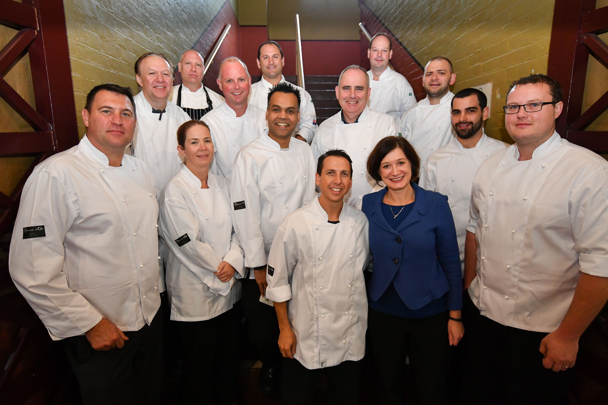 Melbourne, 30 May 2017 - The judges pose for a photograph with Trish Harty of Bocuse d'Or Australia at the Australian selection trials of the Bocuse d'Or culinary competition held during the Food Service Australia show at the Royal Exhibition Building in Melbourne, Australia.   Mark Agius from the William Angliss Institute a judge of the fish plate Donovan Cooke from The Atlantic Restaurant a judge of the fish plate Alexander McIntosh from At The Heads a judge of the fish plate Andre Smaniotto from the Geelong Cats a judge of the fish plate Simon Cosentino former Commis competitor Bocuse d'Or 2007-9 a judge of the meat plate Florent Gerardin from the Newmarket Hotel a judge of the meat plate Deepak Mishra from The Langham Hotel a judge of the meat plate Mark Weatherley from Les Toques Blanches a judge of the meat plate Karen Doyle from Le Cordon Bleu kitchen invigilator judge Glenn Flood from the ALH Group kitchen invigilator judge John McFadden from the Parkroyal Hotel Darling Harbour kitchen invigilator judge Head judge Philippe Mouchel from the Philippe Restaurant kitchen invigilator judge Tom Milligan of the Bocuse d'Or Academy AustraliaPhoto Sydney Low