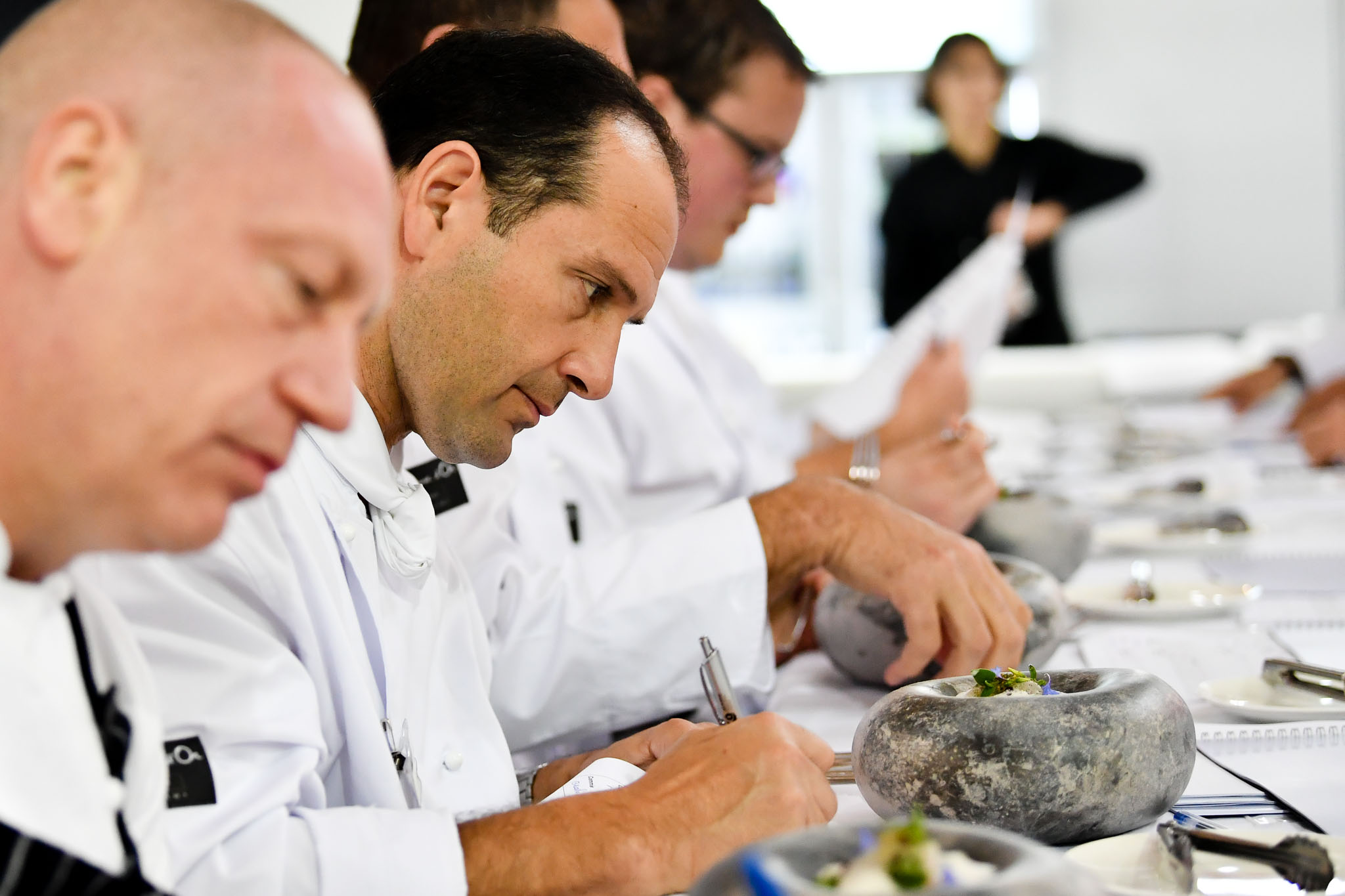 Melbourne, 30 May 2017 - The judges prepare to taste the fish dish of Michael Cole of the Georgie Bass Café & Cookery in Flinders at the Australian selection trials of the Bocuse d'Or culinary competition held during the Food Service Australia show at the Royal Exhibition Building in Melbourne, Australia. Photo Sydney Low