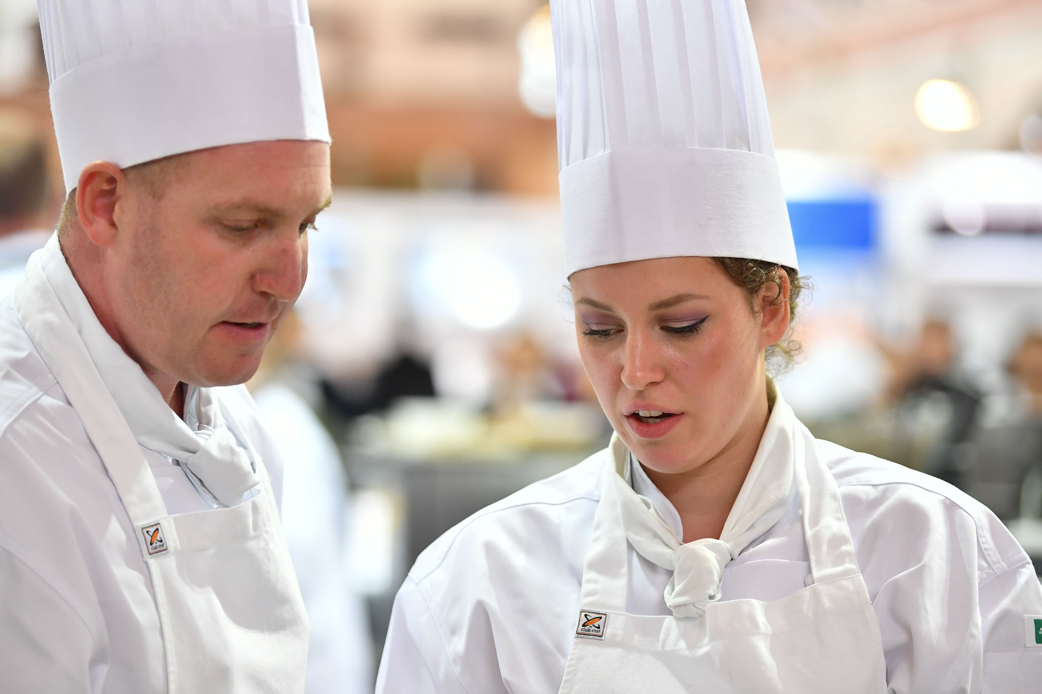 Melbourne, 30 May 2017 - Michael Cole and commis chef Laura Skvor of the Georgie Bass Café & Cookery in Flinders in discussions at the Australian selection trials of the Bocuse d'Or culinary competition held during the Food Service Australia show at the Royal Exhibition Building in Melbourne, Australia. Photo Sydney Low