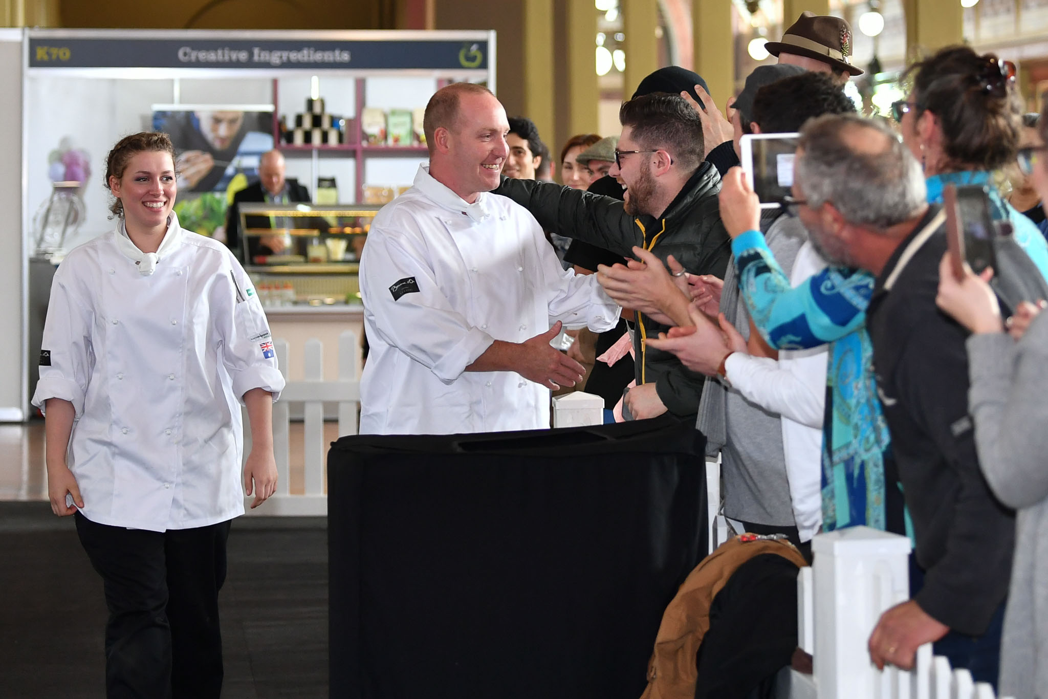 Melbourne, 30 May 2017 - Michael Cole and Laura Skvor of the Georgie Bass Café & Cookery in Flinders celebrate after winning the Australian selection trials of the Bocuse d'Or culinary competition held during the Food Service Australia show at the Royal Exhibition Building in Melbourne, Australia. Photo Sydney Low