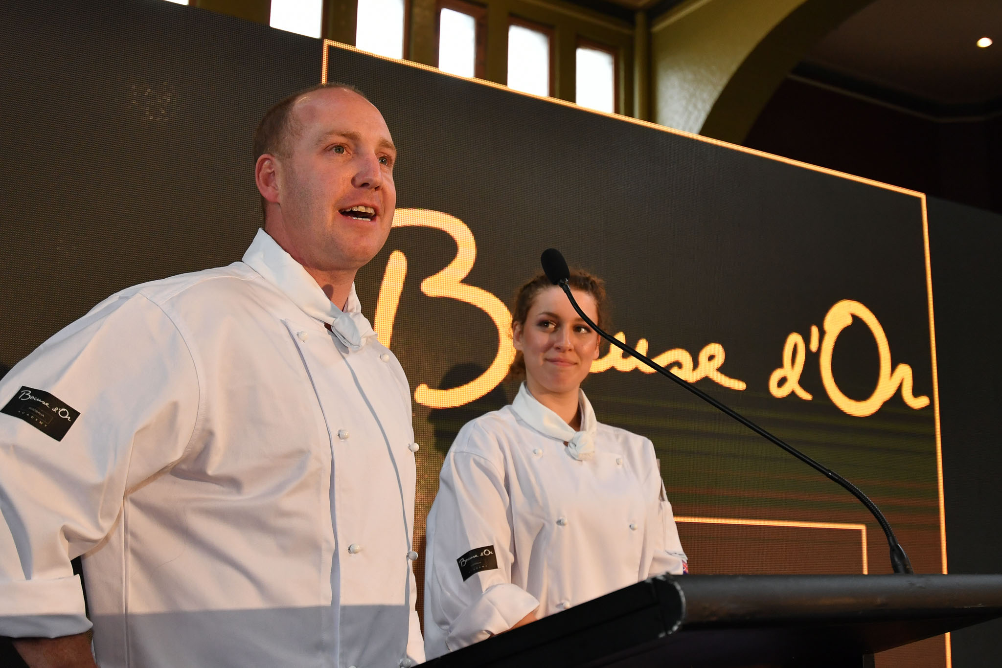 Melbourne, 30 May 2017 - Michael Cole and Laura Skvor of the Georgie Bass Café & Cookery in Flinders speaks to the audience after winning the Australian selection trials of the Bocuse d'Or culinary competition held during the Food Service Australia show at the Royal Exhibition Building in Melbourne, Australia. Photo Sydney Low