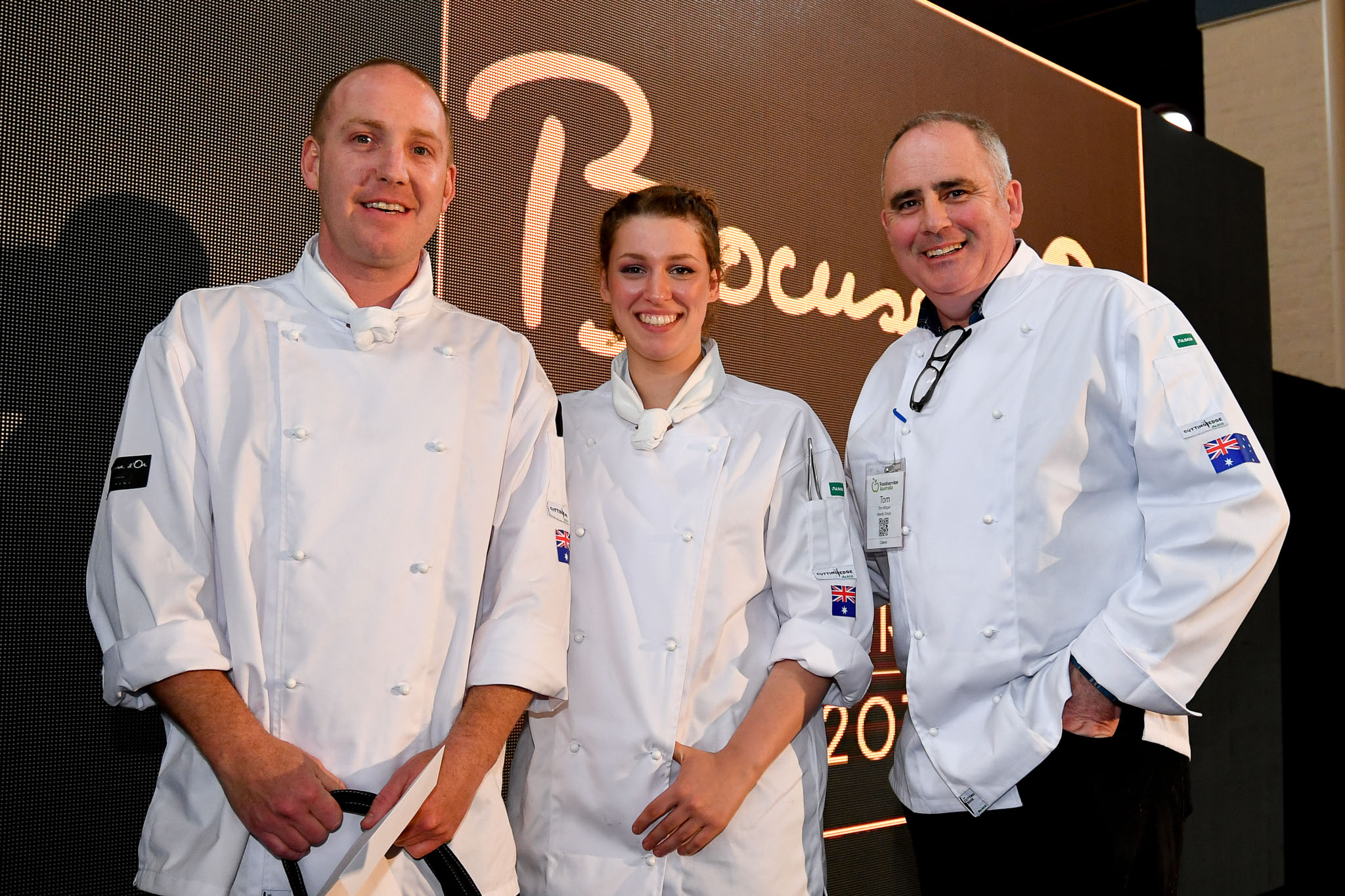Melbourne, 30 May 2017 - Michael Cole and Laura Skvor of the Georgie Bass Café & Cookery in Flinders pose for a photograph with Tom Milligan of the Bocuse d'Or Academy Australia after winning the Australian selection trials of the Bocuse d'Or culinary competition held during the Food Service Australia show at the Royal Exhibition Building in Melbourne, Australia. Photo Sydney Low