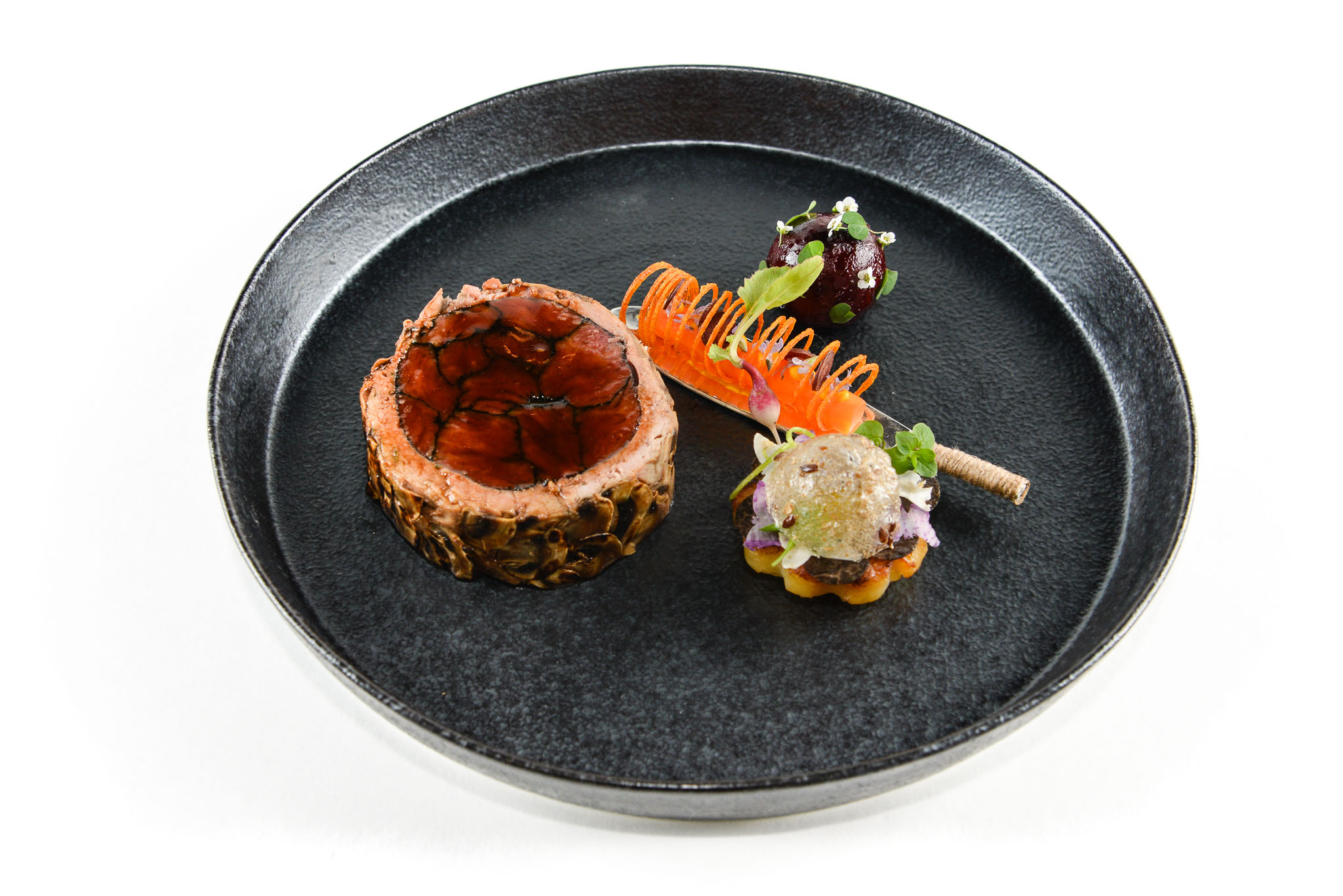 Melbourne, 30 May 2017 - The meat dish by Michael Cole of the Georgie Bass Café & Cookery in Flinders at the Australian selection trials of the Bocuse d'Or culinary competition held during the Food Service Australia show at the Royal Exhibition Building in Melbourne, Australia. Photo Sydney Low