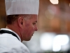 Melbourne, 30 May 2017 - John McFadden from the Parkroyal Hotel Darling Harbour kitchen invigilator judge watches a competitor at the Australian selection trials of the Bocuse d'Or culinary competition held during the Food Service Australia show at the Royal Exhibition Building in Melbourne, Australia. Photo Sydney Low