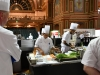 Melbourne, 30 May 2017 - Brendan Bayes commis chef assisting Tyson Kromhout of the Salsa Bar & Grill in Port Douglas works under the gaze of John McFadden from the Parkroyal Hotel Darling Harbour kitchen invigilator judge at the Australian selection trials of the Bocuse d'Or culinary competition held during the Food Service Australia show at the Royal Exhibition Building in Melbourne, Australia. Photo Sydney Low