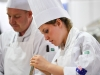 Melbourne, 30 May 2017 - Laura Skvor commis chef assisting Michael Cole of the Georgie Bass Café & Cookery in Flinders prepares a garnish at the Australian selection trials of the Bocuse d'Or culinary competition held during the Food Service Australia show at the Royal Exhibition Building in Melbourne, Australia. Photo Sydney Low