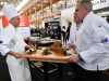 Melbourne, 30 May 2017 - Tom Milligan of the Bocuse d'Or Academy Australia helps Michael Cole of the Georgie Bass Café & Cookery in Flinders present his meat platter at the Australian selection trials of the Bocuse d'Or culinary competition held during the Food Service Australia show at the Royal Exhibition Building in Melbourne, Australia. Photo Sydney Low